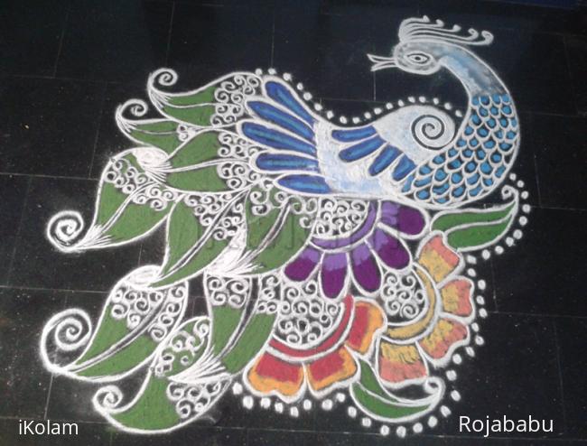 Rangoli: Peacock in leaves n flowers