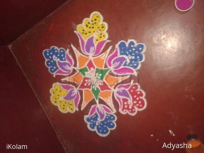 Rangoli: Flower and peacock rangoli