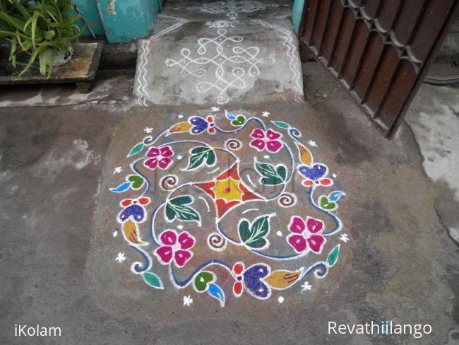 Rangoli: Creeper with colour colour flowers.