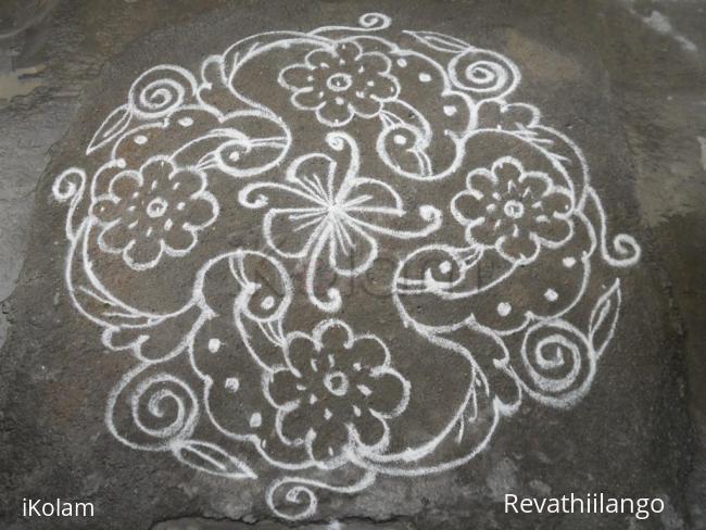 Rangoli: Bird & flower kolam.