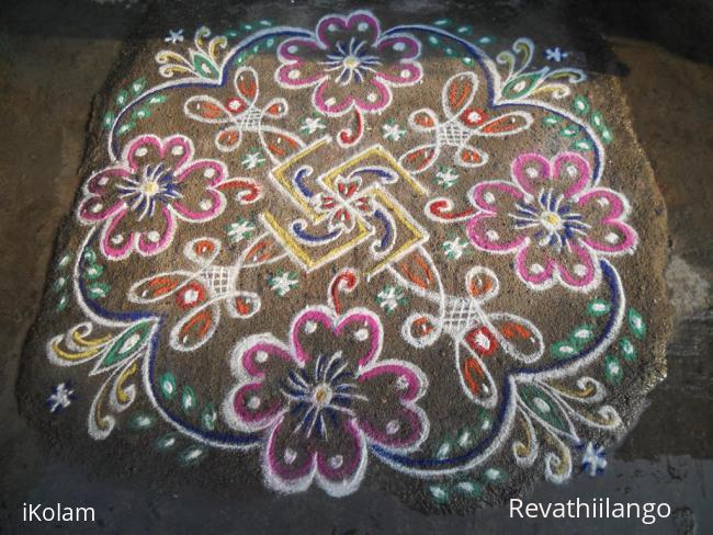 Rangoli: Rev's swasthik, chikku & flower kolam.