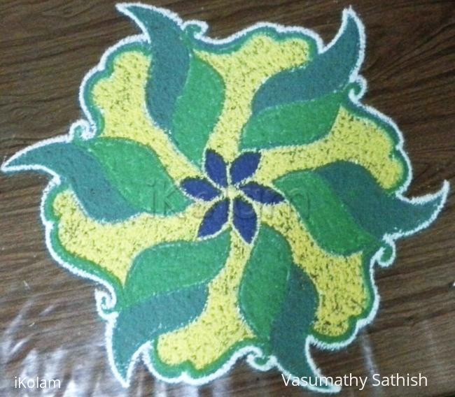 Rangoli: A dotted rangoli with 9-5 interlaced dots