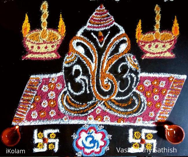 Rangoli: Simple Ganesha kolam with rice flour, haldi, Kumkum.