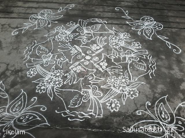 Rangoli: Ducks with boaque...